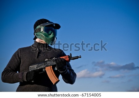 Aisoft player holding a rifle - stock photo