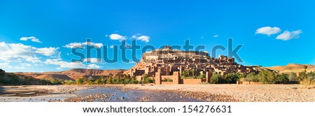 Ait Benhaddou,fortified city, kasbah or ksar, along the former caravan route between Sahara and Marrakech in present day Morocco. It is situated in Souss Massa Draa on a hill along the Ounila River. - stock photo