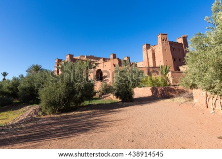 Ait Benhaddou, fortified city, kasbah or ksar, along the former caravan route between Sahara and Marrakesh in present day Morocco. It is situated in Souss Massa Draa on a hill along the Ounila River. - stock photo