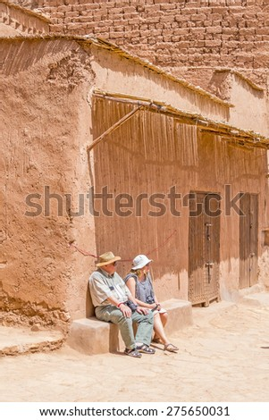 Ait Benhaddou, Morocco: Elderly father with daughter rest in old city - stock photo