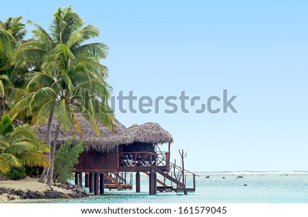 "AITUTAKI - SEP 20:Beach Bungalows in Aitutaki Lagoon on Sep 20 2013.In June 2010 the island was nominated ""the world's most beautiful island"" by Tony Wheeler the founder of Lonely Planet travel guide"