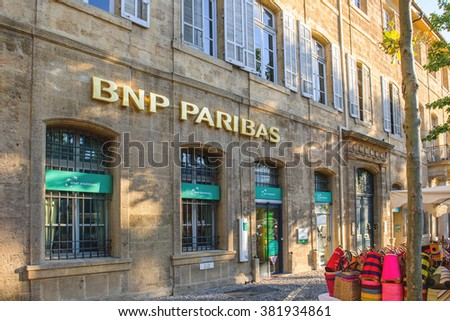 AIX-EN-PROVENCE, FRANCE - JUL 17, 2014: BNP PAribas main entrance in the Provence bank branch. BNP Paribas is a French multinational bank and financial services company  - stock photo