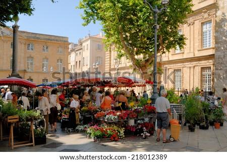 AIX-EN-PROVENCE, FRANCE - JUNE 28: Market in Aix-en-Provence, France. June 28, 2008 in Aix-en-Provence, Provence-Alpes-Cote d'Azur, France - stock photo