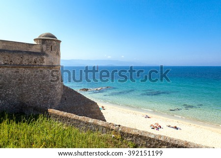 Ajaccio,  France - July 2, 2009: Corsica island, people sunbathing on the beach of the Citadel