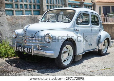 Ajaccio, France - July 6, 2015: Light blue Renault 4CV old-timer economy car stands parked on a roadside in French town
