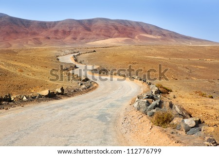 Ajaches mountain road in Lanzarote Punta Papagayo at Canary Islands - stock photo