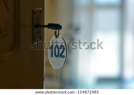 Ajar door of a hotel room - stock photo
