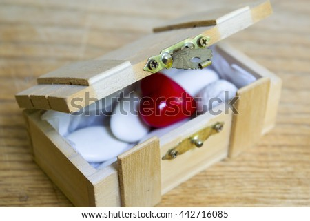 Ajar wooden chest with white candies and a red porcelain hearth inside