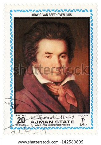 AJMAN - CIRCA 1972: A stamp printed in Ajman shows a portrait of German composer Ludwig van Beethoven in 1815, series, circa 1972 - stock photo