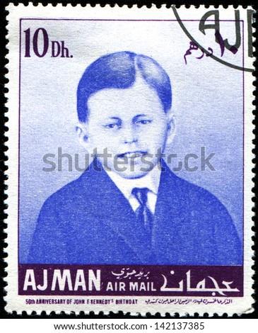 AJMAN - CIRCA 1967: A stamp printed in Ajman shows John F. Kennedy - boy, circa 1967 - stock photo