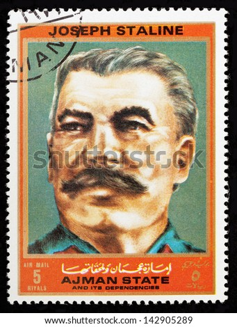 AJMAN - CIRCA 1972: A stamp printed in Ajman shows Joseph Staline (1878-1953), series Figures from the Second World War, circa 1972 - stock photo