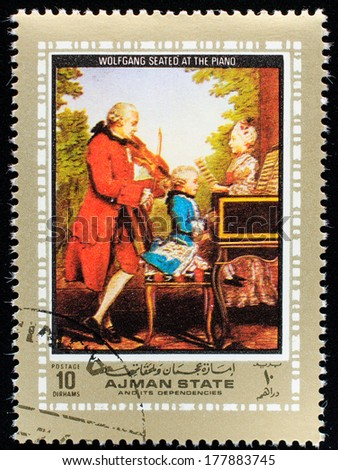 AJMAN - CIRCA 1972: A stamp printed in Ajman shows portrait of the great musician and composer Wolfgang Amadeus Mozart, circa 1972  - stock photo