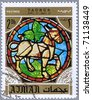 AJMAN - CIRCA 1971: A stamp printed in Ajman shows the horoscope sign of Taurus, series is devoted to the frescoes in the cathedral of Notre Dame, circa 1971 - stock photo