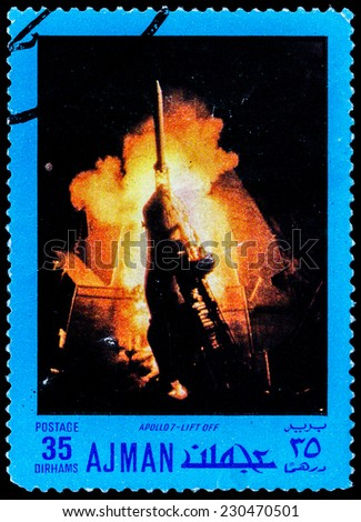 "AJMAN - CIRCA 1970: A stamp printed in United Arab Emirates from the ""Space exploration"" issue shows Apollo VII lift off, circa 1970.  - stock photo"