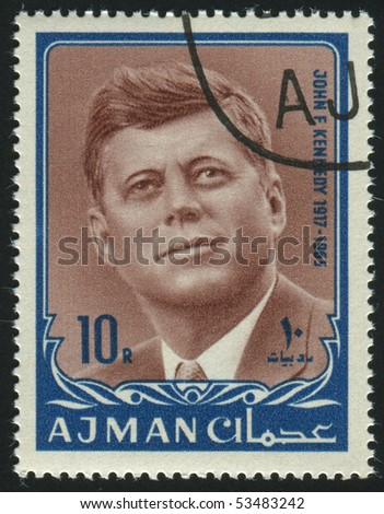 AJMAN - CIRCA 1963: stamp printed by Ajman, shows John Fitzgerald Kennedy was the 35th President of the United States, circa 1963.