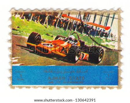 AJMAN - CIRCA 1973: stamp printed by Ajman state, shows old formula car, circa 1973 - stock photo
