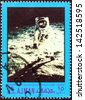 "AJMAN EMIRATE - CIRCA 1970: A stamp printed in United Arab Emirates from the ""Space exploration"" issue shows Lunar bug reflected in Aldrin's visor, circa 1970. - stock photo"