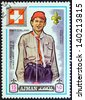 """AJMAN EMIRATE - CIRCA 1971: A stamp printed in United Arab Emirates from the """"13th World Boy Scout Jamboree - Japan"""" issue shows boy scout from Switzerland, circa 1971. - stock photo"""
