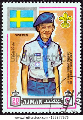 "AJMAN EMIRATE - CIRCA 1971: A stamp printed in United Arab Emirates from the ""13th World Boy Scout Jamboree - Japan"" issue shows boy scout from Sweden, circa 1971. - stock photo"