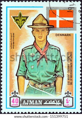 "AJMAN EMIRATE - CIRCA 1971: A stamp printed in United Arab Emirates from the ""13th World Boy Scout Jamboree - Japan"" issue shows boy scout from Denmark, circa 1971.  - stock photo"