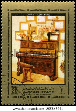 AJMAN STATE - CIRCA 1972: A used postage stamp from Ajman State, featuring an image of Frederic Chopin�¢??s Pleyel Piano, circa 1972. - stock photo