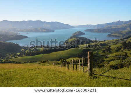 Akaroa Harbour viewed from the Summit Road at Dawn, New Zealand - stock photo