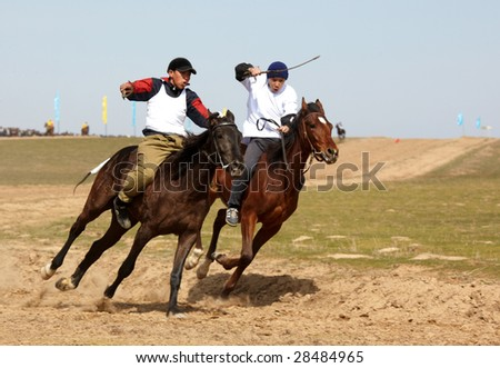 AKCHI, KAZAKHSTAN - MARCH 22 : A traditional national nomad long-distance horse riding competition Bayga  in action on MARCH 22, 2009 in Akchi, Kazakhstan.