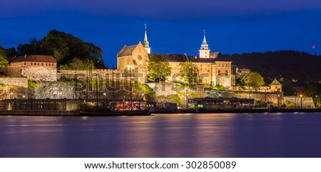 Akershus fortress and castle at night in Oslo, Norway.