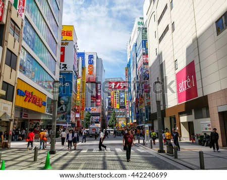 AKIHABARA, JAPAN - SEPTEMBER 21: Unidentified person walking on the street on September 21,2014 in Akihabara Railway Station, Japan. With many buildings and shops along the street