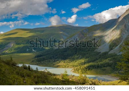 Akkem valley is Akkem lake and Akkem river near Belukha peak. Sections of search and rescue station ashore, Altai. Russia - stock photo