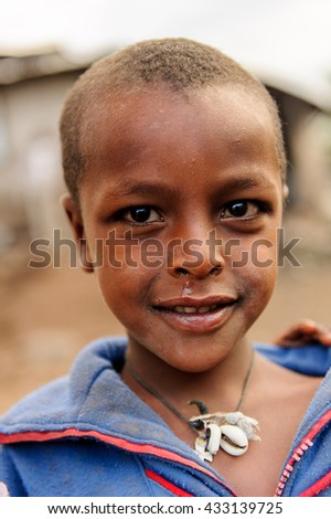 AKSUM, ETHIOPIA - SEP 27, 2011: Portrait of an unidentified Ethiopian child wearing old clothes in Ethiopia, Sep.27, 2011. Children in Ethiopia suffer of poverty due to the unstable situation