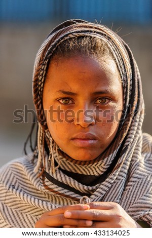 AKSUM, ETHIOPIA - SEP 30, 2011: Portrait of an unidentified Ethiopian girl wearing old clothes in Ethiopia, Sep.30, 2011. People in Ethiopia suffer of poverty due to the unstable situation