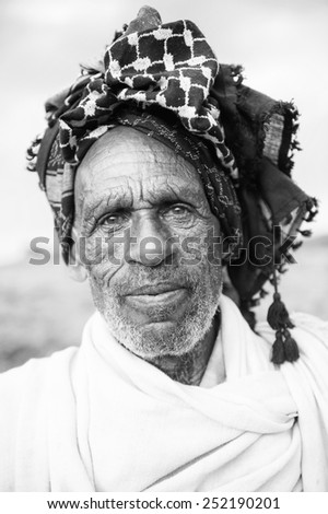 AKSUM, ETHIOPIA - SEP 26, 2011: Portrait of an unidentified Ethiopian old man in Ethiopia, Sep.26, 2011. People in Ethiopia suffer of poverty due to the unstable situation - stock photo