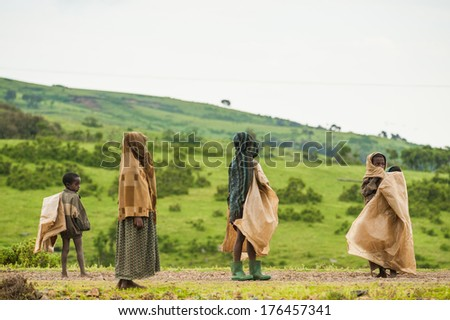 AKSUM, ETHIOPIA - SEPTEMBER 22, 2011: Unidentified Ethiopian children walk with the natural background. People in Ethiopia suffer of poverty due to the unstable situation - stock photo