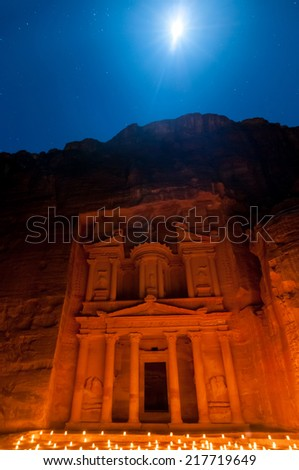 Al Khazneh in Petra, Jordan. Al Khazneh was carved out of a sandstone rock face. It has classical Greek-influenced architecture. It is known as the Treasury. - stock photo