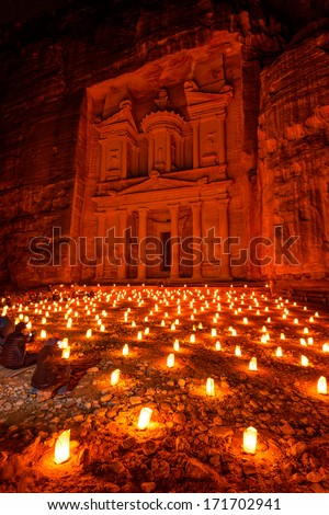 Al Khazneh in Petra, Jordan at night. Al Khazneh was carved out of a sandstone rock face. It has classical Greek-influenced architecture. It is known as the Treasury.  - stock photo