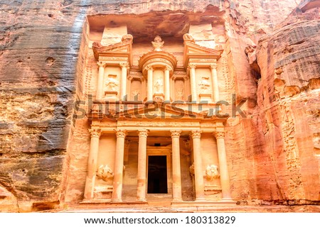 Al Khazneh is one of the most elaborate temples in the ancient Jordanian city of Petra, Jordan. It is known as The Treasury. Petra has led to its designation as a UNESCO World Heritage Site. - stock photo