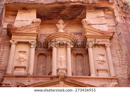 Al Khazneh or The Treasury at Petra, Jordan-- it is a symbol of Jordan, as well as Jordan's most-visited tourist attraction. Petra has been a UNESCO World Heritage Site since 1985 - stock photo