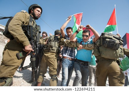 AL MA'SARA, PALESTINIAN TERRITORY - OCTOBER 19: Palestinians protest the Israeli separation wall, which if built as planned would cut off Al Ma'sara, West Bank from agricultural lands, Oct. 19, 2012.