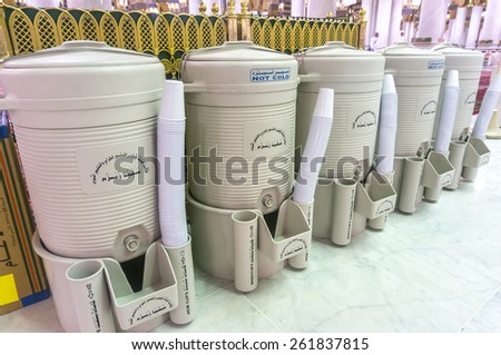 AL MADINAH, KINGDOM OF SAUDI ARABIA - MARCH 3: Rows of drums of zamzam water inside Masjid Nabawi on March 3, 2015 in Al Madinah, S. Arabia. Zamzam water are freely and available in abundant here  - stock photo