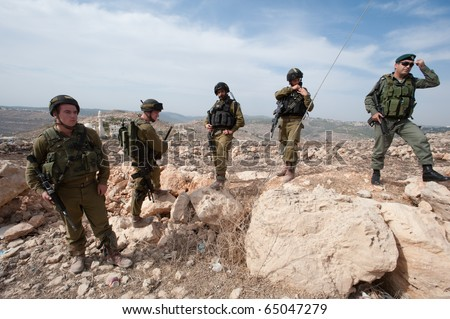 AL-WALAJA - NOVEMBER 13: Israeli soldiers stand by during a nonviolent protest against the Israeli separation barrier on Nov. 13, 2010 in Al-Walaja.