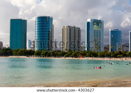 Ala Moana beach park fronting the downtown skyline in Honolulu, Hawaii - stock photo