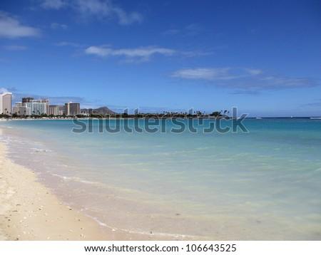 Ala Moana Beach Park on a nice day with Waikiki and Diamond Head in the distance on Oahu. - stock photo