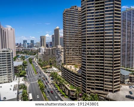 Ala Moana Boulevard in Waikiki facing in a northerly direction. Honolulu skyline visible.  - stock photo