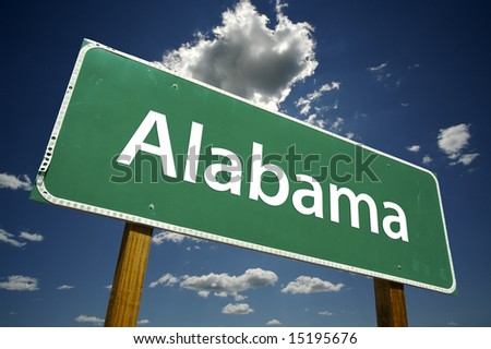 Alabama Road Sign with dramatic clouds and sky. - stock photo