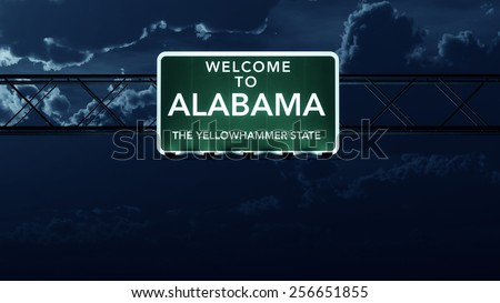 Alabama USA State Welcome to Interstate Highway Road Sign at Night - stock photo