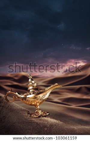 Aladdin magic lamp on a desert - stock photo