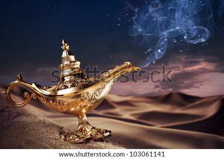 Aladdin magic lamp on a desert with smoke - stock photo