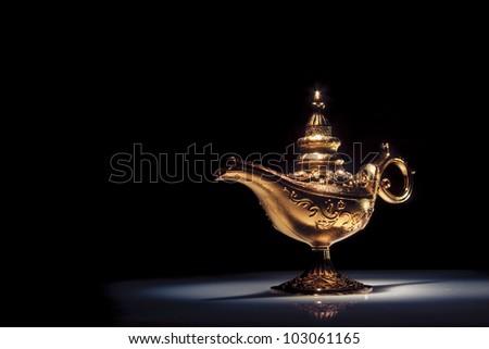 aladdin magic lamp on black - stock photo
