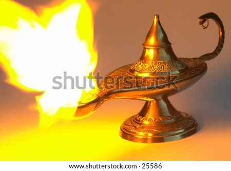 Aladdin's Lamp - yellow version, with a real flame - stock photo